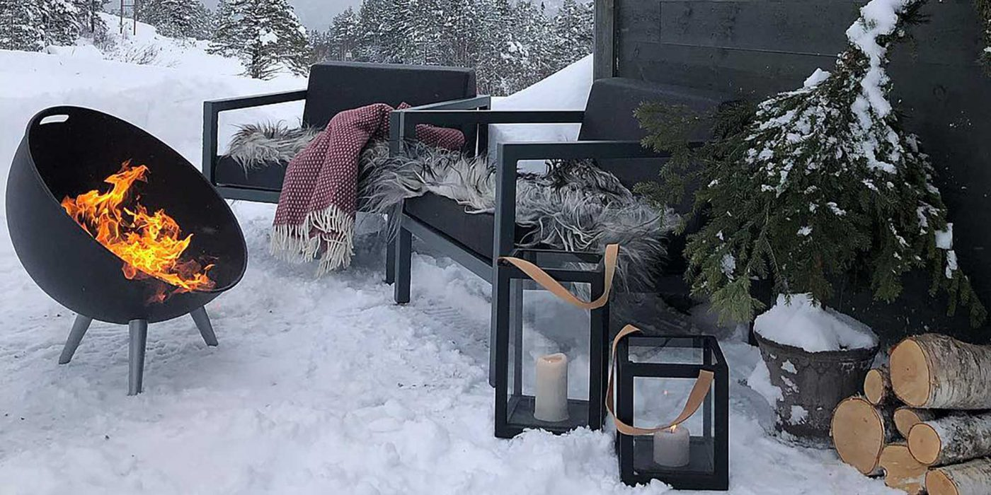 Sundays Frame lounge outdoor furniture with snow and fireplace